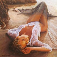 sensuous mermaid resting on beach