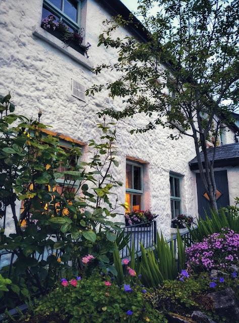 white gables restaurant image outside, flowers