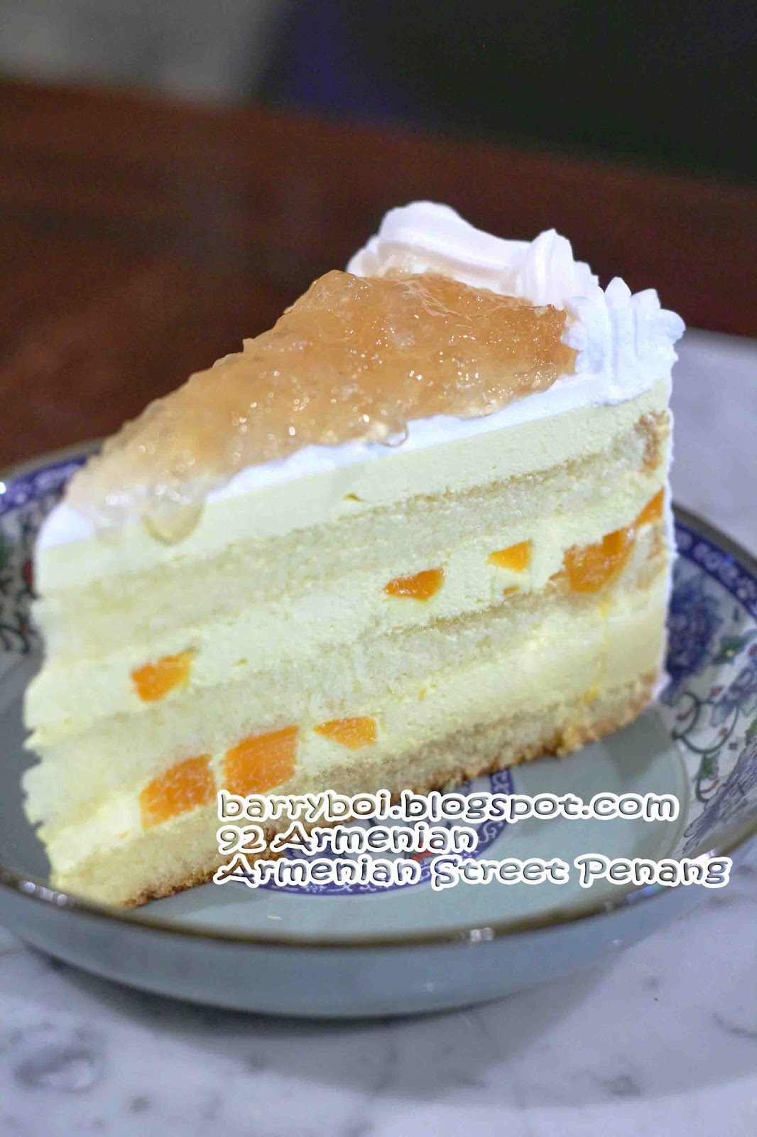 Layers Of Moist Sponge, With Chunks Of Sweet Delicious And Irresistible  Mango With Mango Flavoured Cream With A Spread Of Bird's Nest On It,