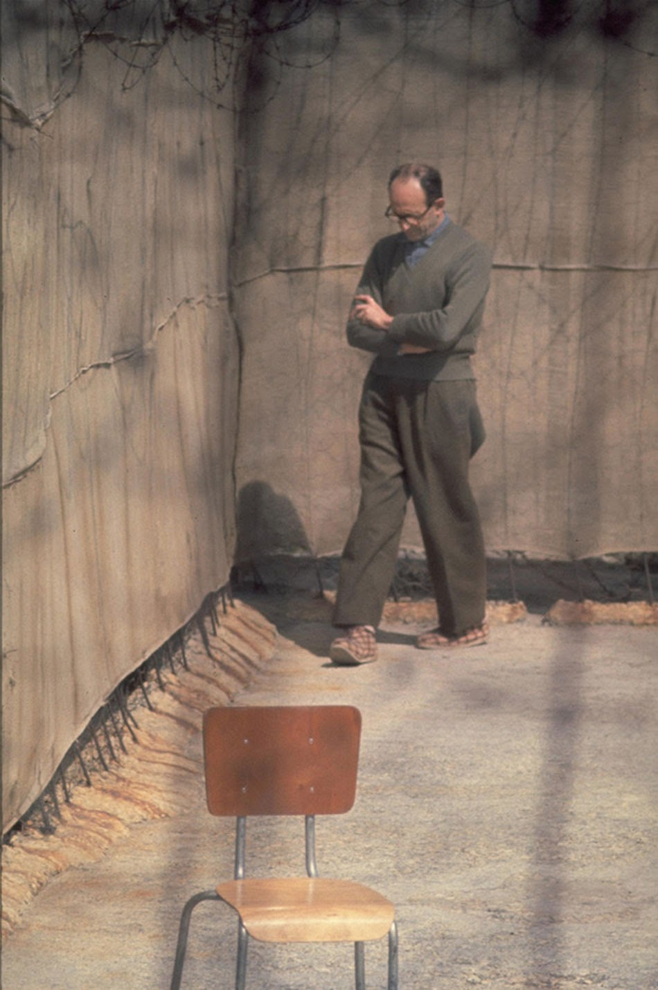 Adolf Eichmann walks around the yard of his cell, Israel, 1961