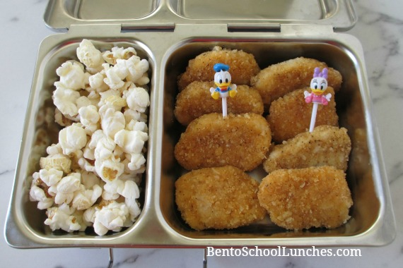 Nuggets and popcorn with Donald Duck and Daisy food picks.