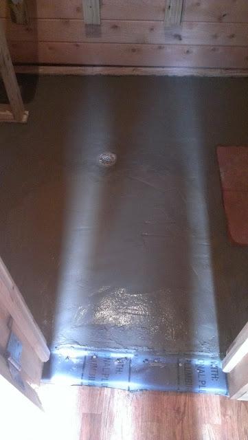 Last piece of the sauna hot room floor being cemented.