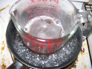 Dissolving gum arabic on a stove top.