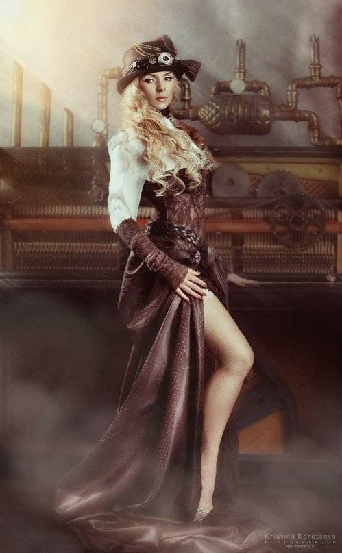 Steampunk girl in sexy skirt with high cut slit showing a lot of leg. She wears a white blouse with lace arm warmer sleeves, a lace underbust corset and a bowler hat with gears on it. Women's steampunk clothing.