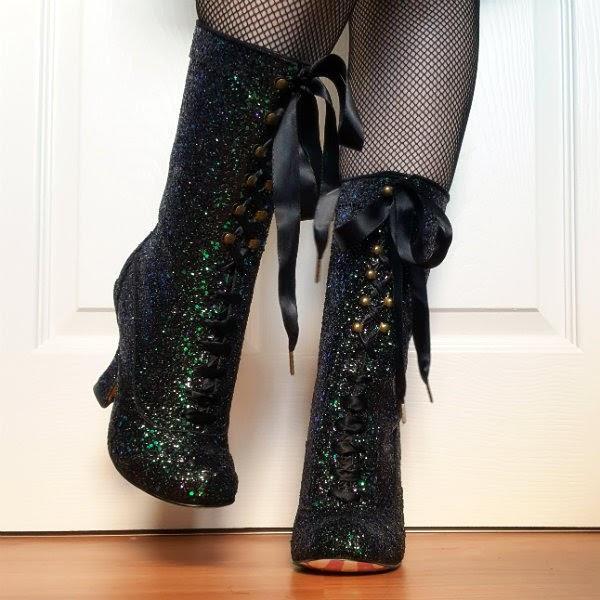 legs wearing black Gothic glitter boots