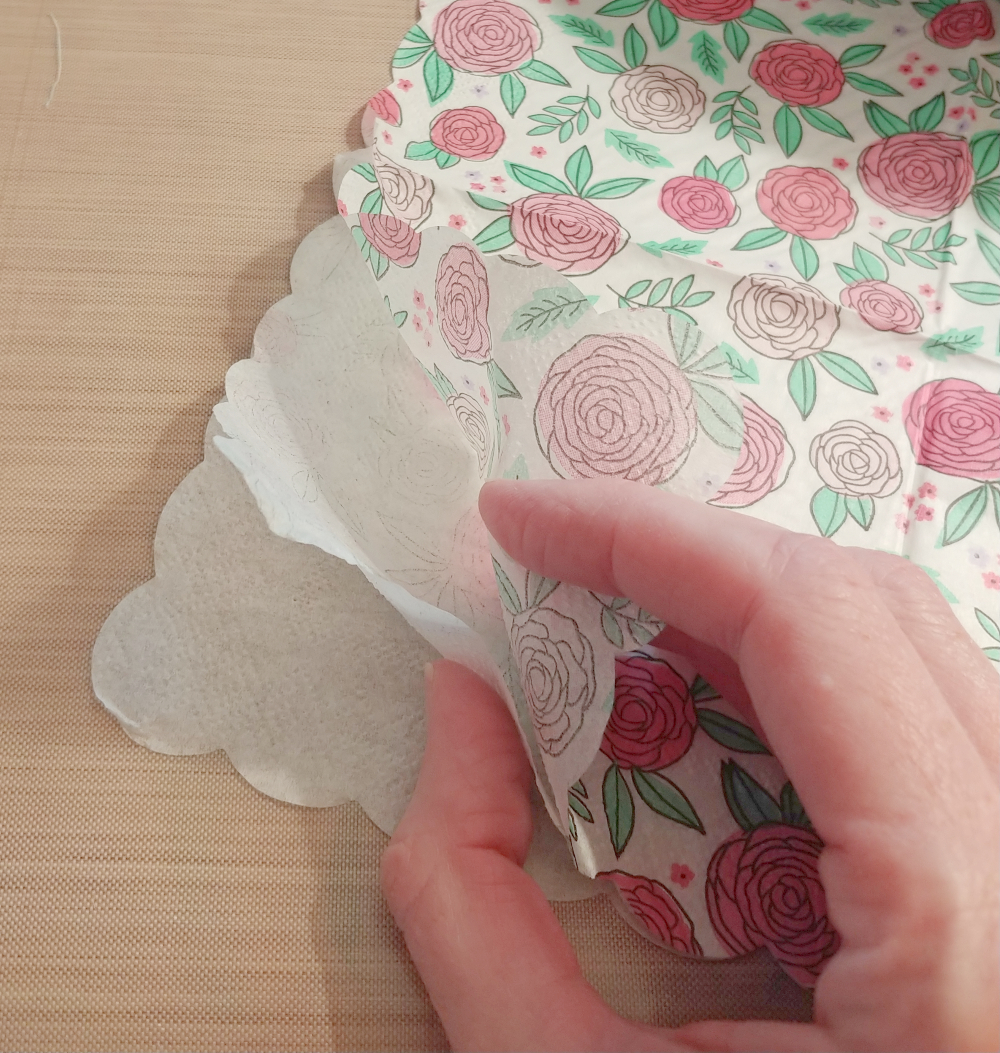 Separate layers of napkin