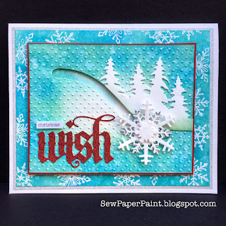 http://sewpaperpaint.blogspot.com/2017/10/interactive-tim-holtz-snowflake-spinner.html