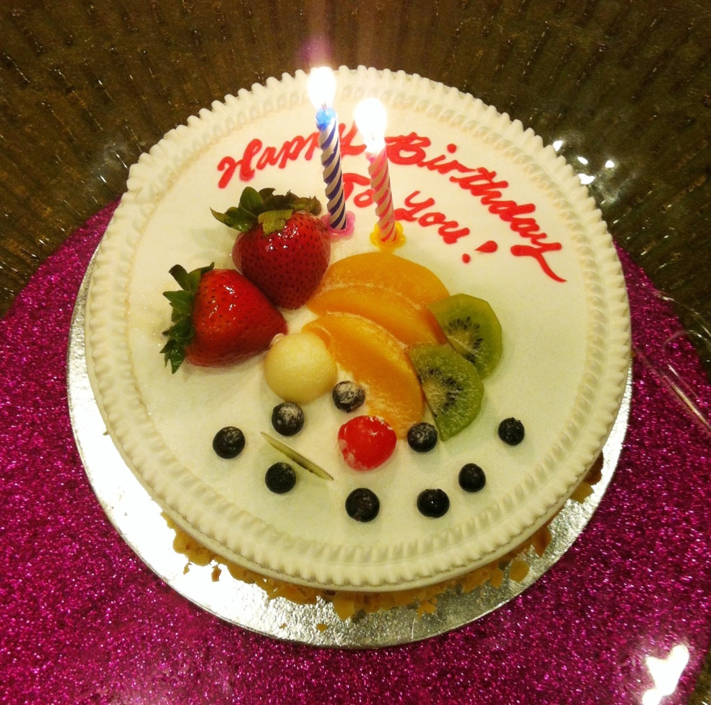 Happy Birthday Fruit Cake With Candle Images Wishes