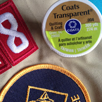 Use clear thread to sew scout patches onto uniforms