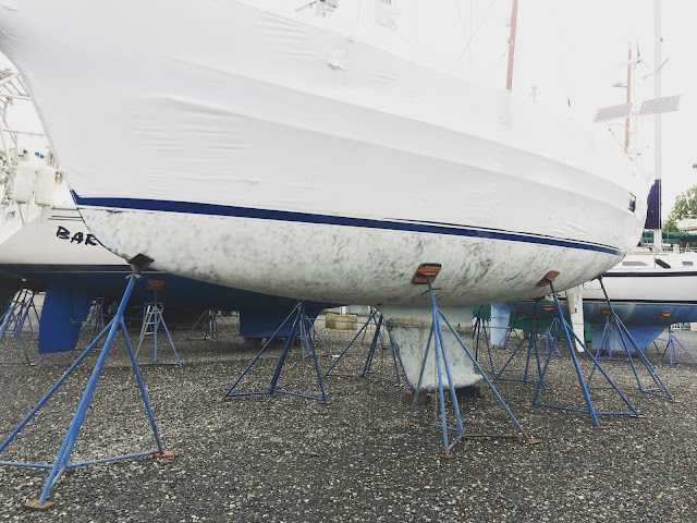 Hallberg-Rassy 37 on jackstands in boatyard after soda blasting