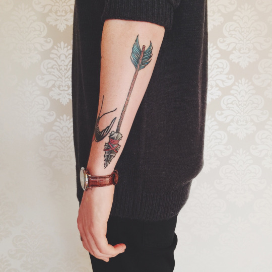 Creative Arrow Tattoo Design
