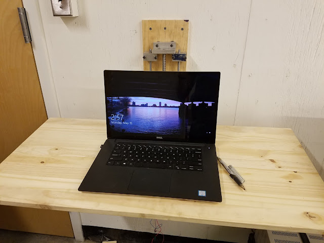 laptop posed on desk at seated-height setting