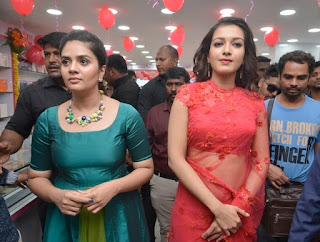 Catherine Tresa in transparent saree with Srimukhi at a mobile store launch in tur