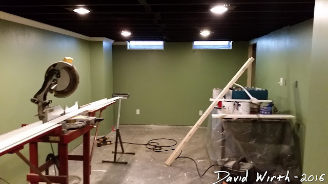 basement baseboard, crown molding, paint, finished basement