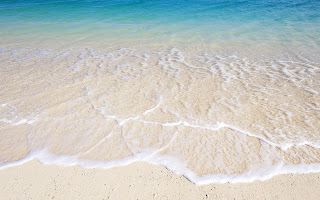 Zand strand en water