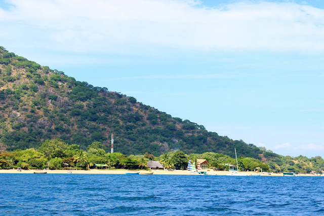 The view of Cape McClear from Lake Malawi. Can you spot Danforth's colourful sails in the background?