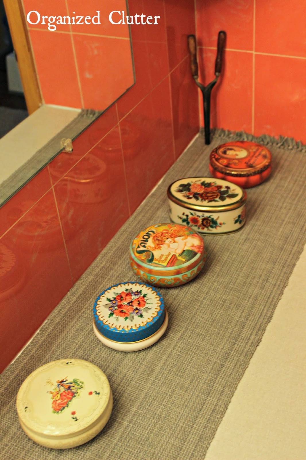 Powder Tins in a  Vintage Bathroom www.organizedclutterqueen.blogspot.com