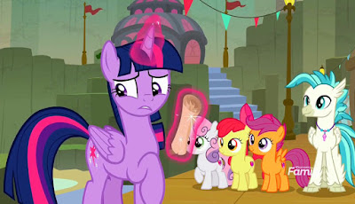 Twilight, levitating a scroll, looks uncertain and glances behind her as the CMC and Terramar look on