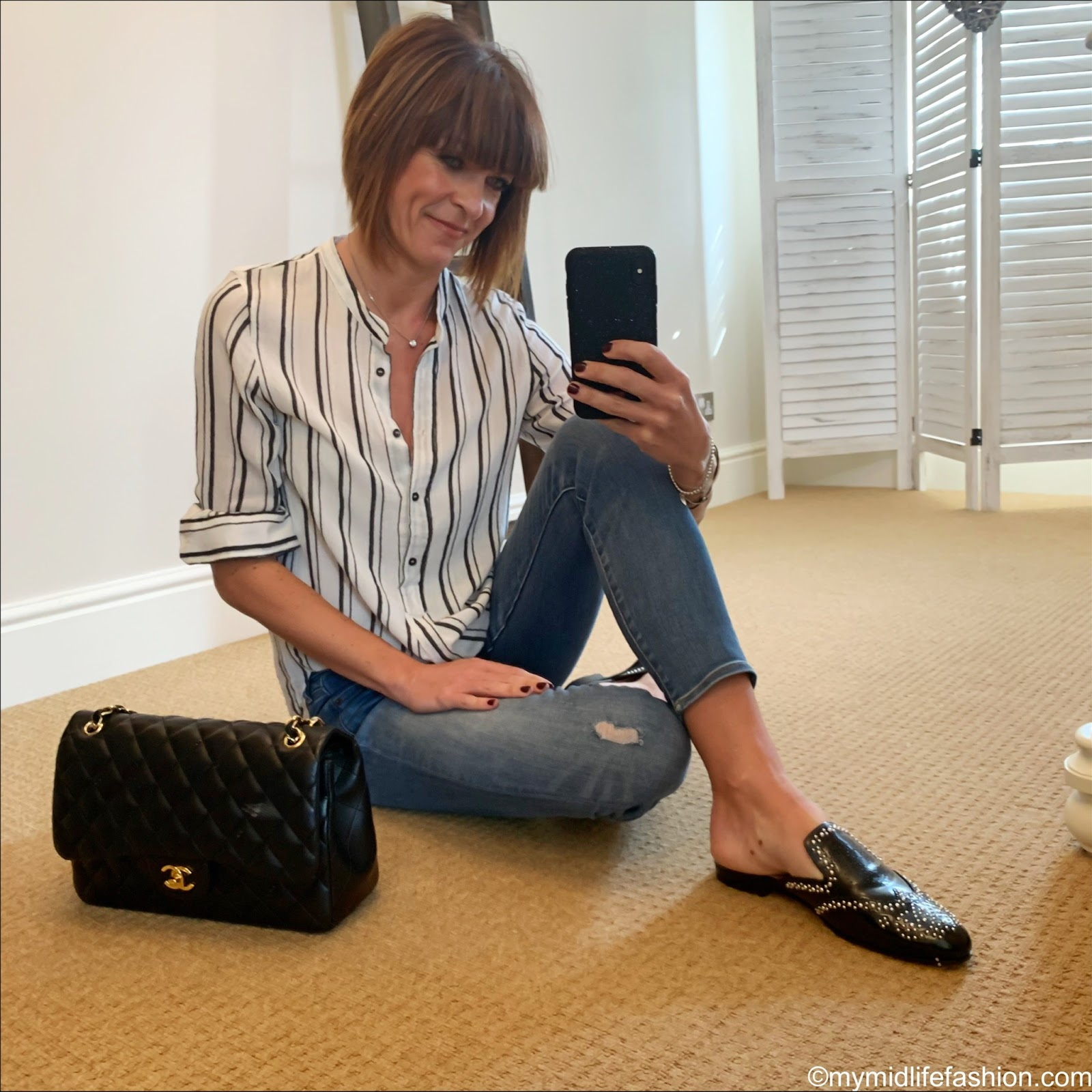 my midlife fashion, Isabel Marant Etoile stripe shirt, j crew 9 inch stretch toothpick jeans, Chanel quilted handbag, j crew studded academy penny loafer mules