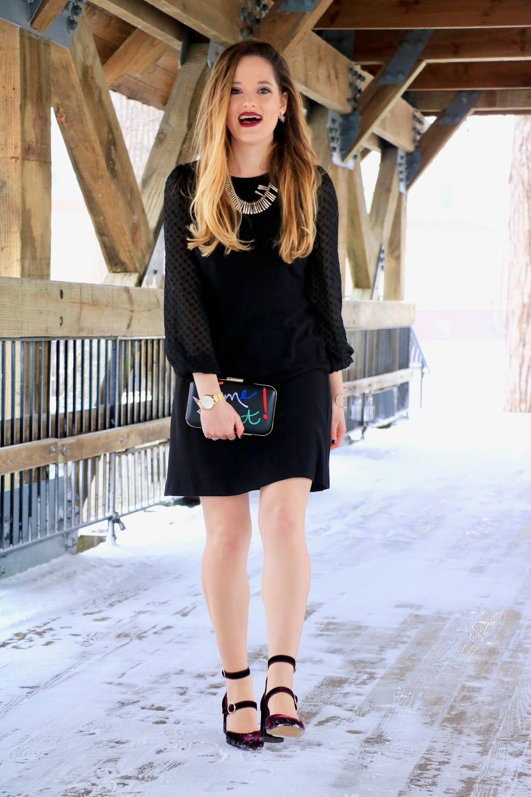 Nyc fashion blogger Kathleen Harper showing how to wear a dress in the winter