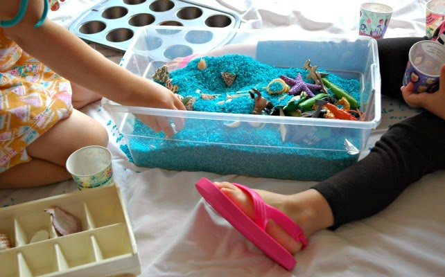 blue rice ocean sensory bin, girls playing with sea animals