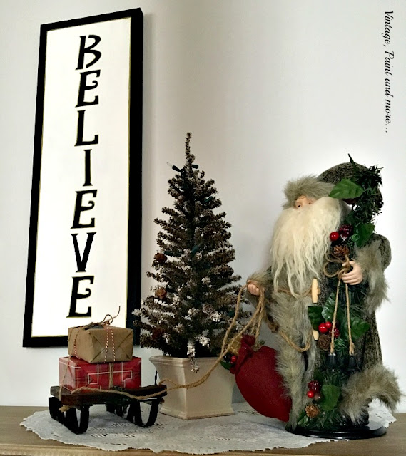 DIY BELIEVE sign done on recycled canvas, vintage sleigh with faux packages, Santa and mini tree