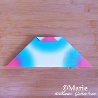 Triangle paper folded blue and pink