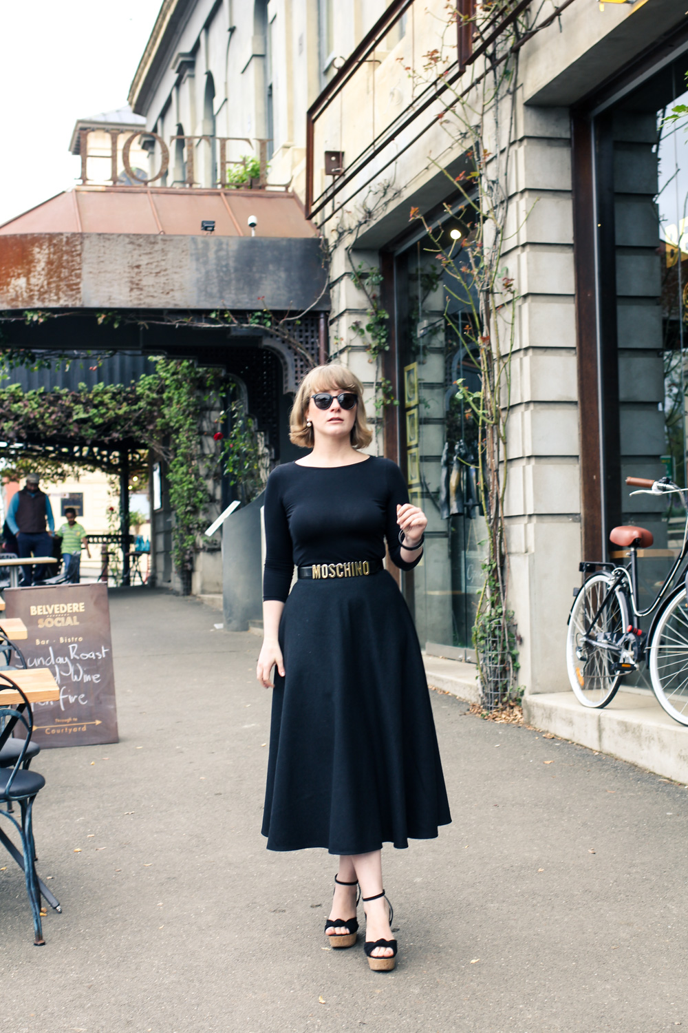 Liana of @findingfemme wearing black Moschino belt at the Belvedere Social in Daylesford