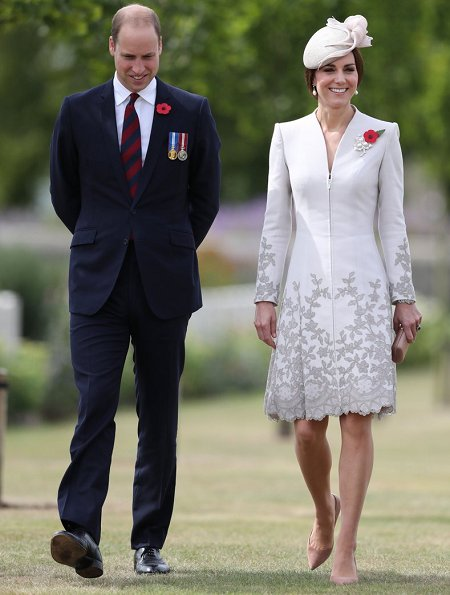 Kate Middleton wore Catherine Walker dress. Queen Mathilde wore Natan Dress. Prince Charles, Prince William and Catherine, Duchess of Cambridge