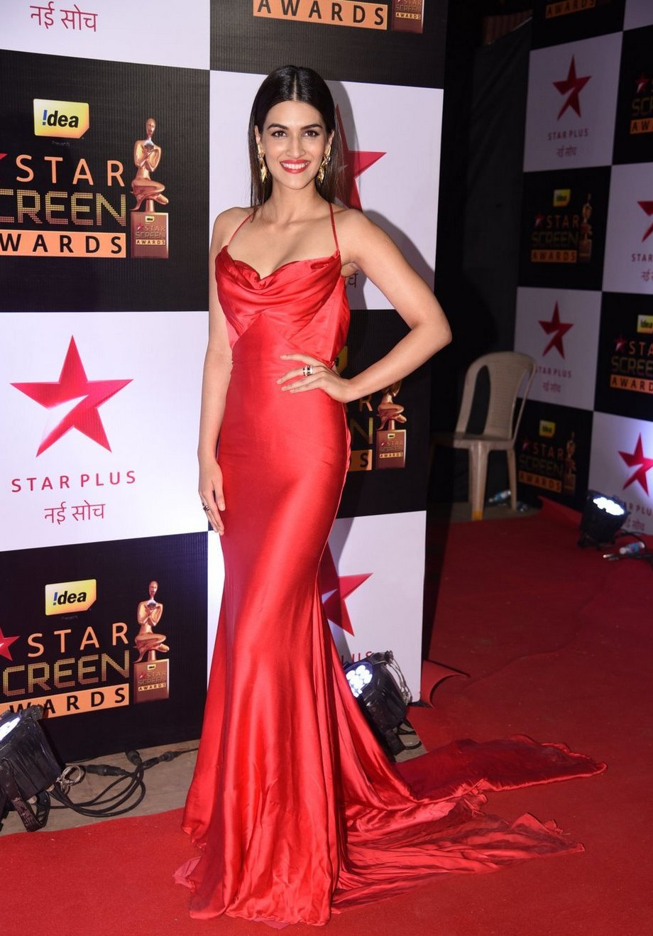 Model Kriti Sanon Hot Big teeths Photos In Red Dress
