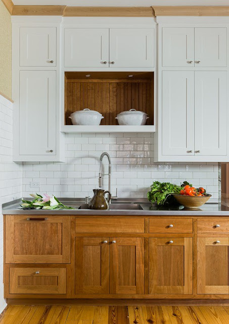 Modern farmhouse kitchen with stained wood base cabinets and white uppers found on Hello Lovely