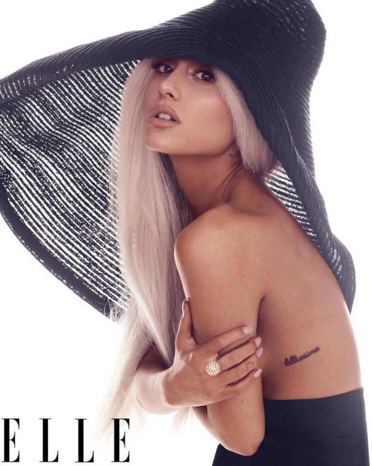 Singer Ariana Grande wears Jacquemus hat and pants with Tiffany & Co. ring