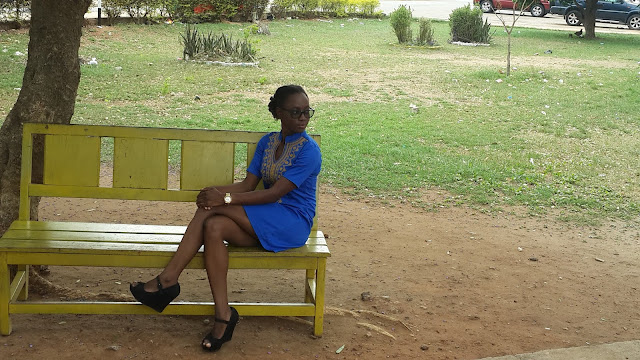 blue dress, black wedges, yellow bench