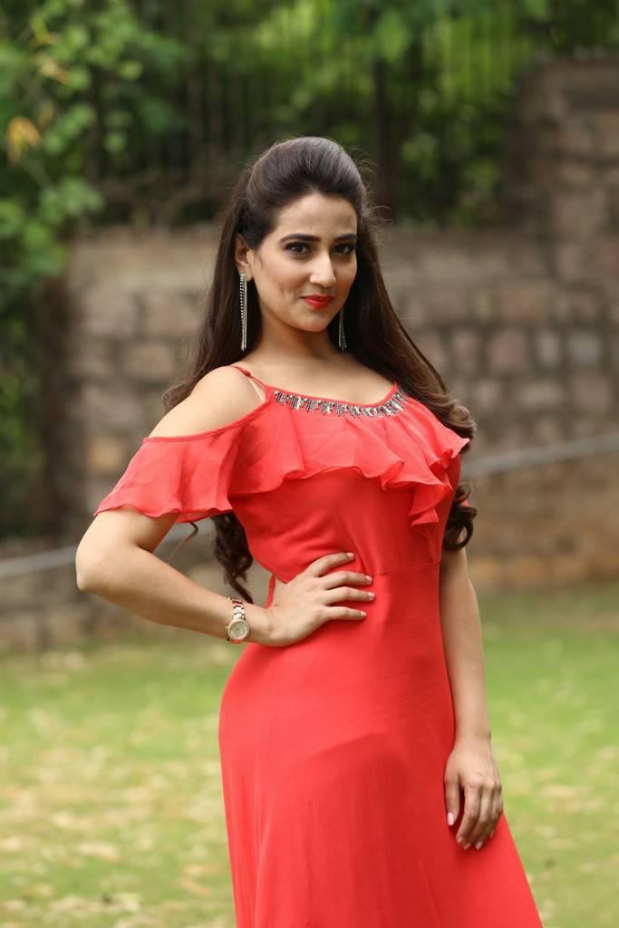 Telugu TV Anchor Manjusha Long Hair Stills In Pink Dress At Trailer Launch