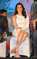 Beautiful Smiling Kajal Aggarwal in Creamy White Gown at MLA Telugu Movie Success Meet ~ .com Exclusive Pics 016.jpg