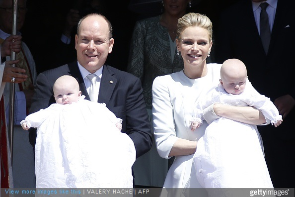 Prince Albert II of Monaco and his wife Princess Charlene pose outside the cathedral after the baptism of their twins Prince Jacques and Princess Gabriella in Monte Carlo, on May 10, 2015.