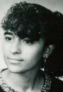 A high school photo of an Hispanic girl with fluffy hair