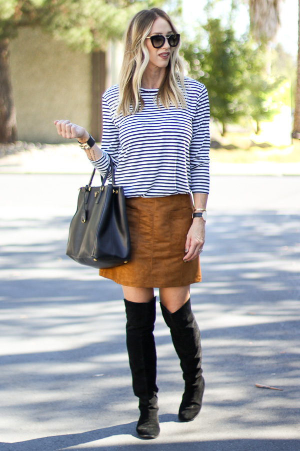 black and white striped top with suede skirt and over the knee boots