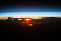 Sun, Earth's Atmosphere and Clouds over Pacific Ocean seen from the International Space Station