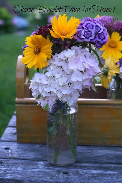 garden flowers vintage milk bottles wooden tool box centerpiece