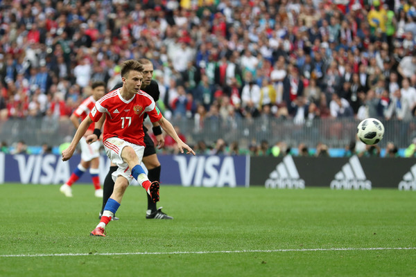 Aleksandr Golovin of Russia scores his team's fifth goal during the 2018 FIFA World Cup Russia Group A match between Russia and Saudi Arabia at Luzhniki Stadium on June 14, 2018 in Moscow, Russia.