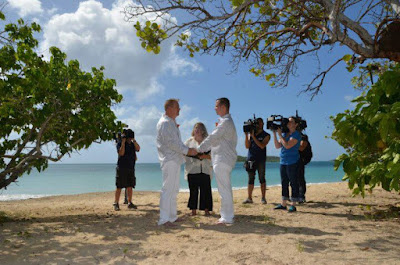 Sandy Marrying a Couple on TV