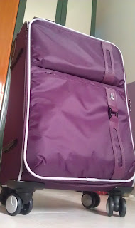 Hush Puppies purple luggage