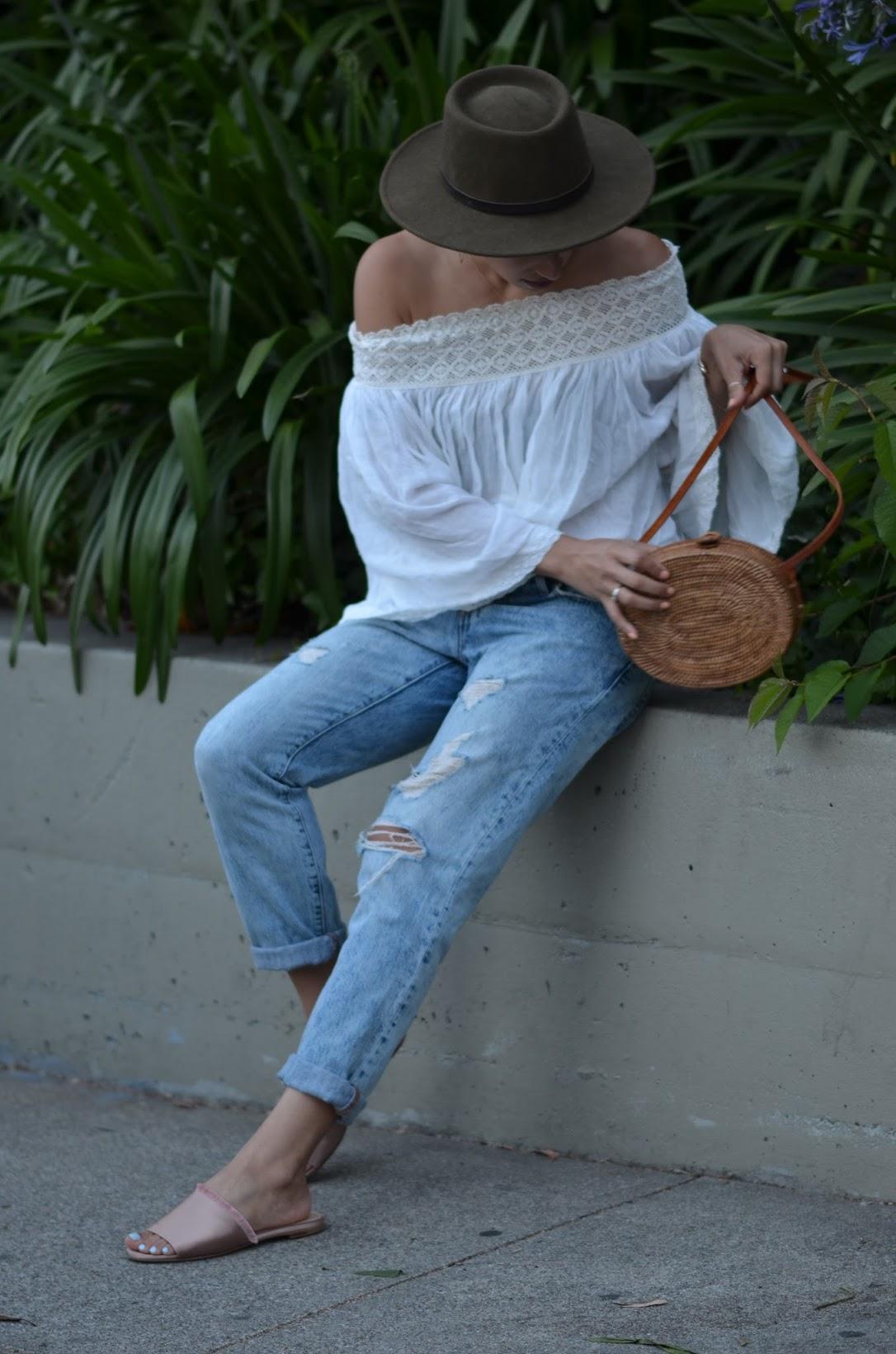 M. Gemi Tenidas, off the shoulder linen top, straw bag from Bali, round straw bag, Levi's 501