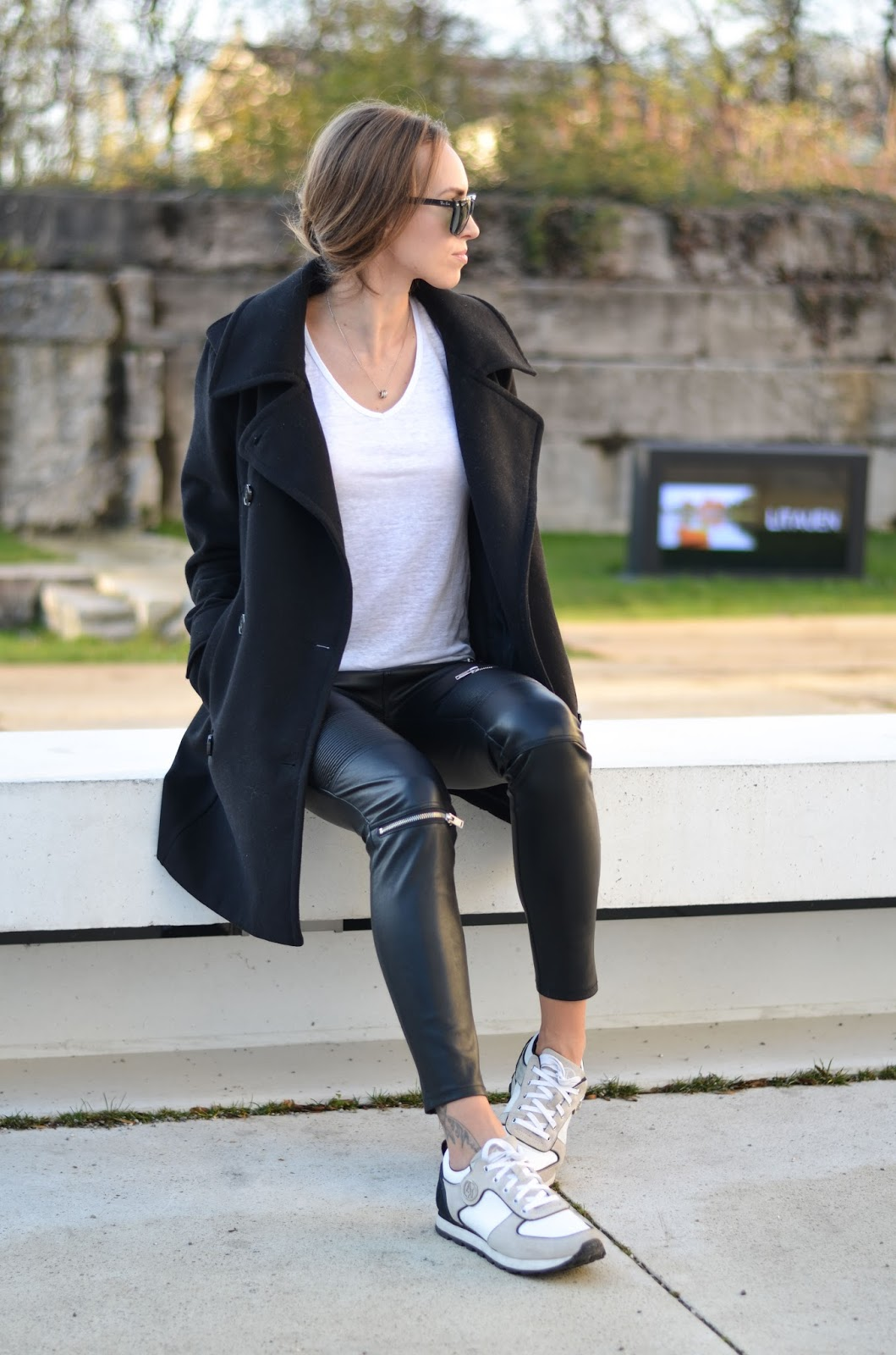 kristjaana mere black peacoat leather pants white sneakers winter outfit