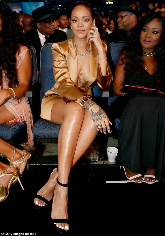 Rihanna goes braless in a gold ensemble at the 2015 BET Awards in LA