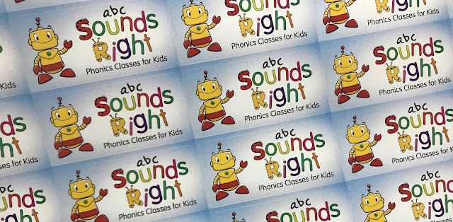 A sheet of sticker with a yellow robot on and saying abc sounds right phonic classes for kids