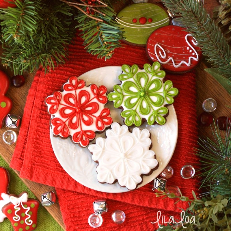 Simple and elegant snowflake sugar cookies in red, white, and green