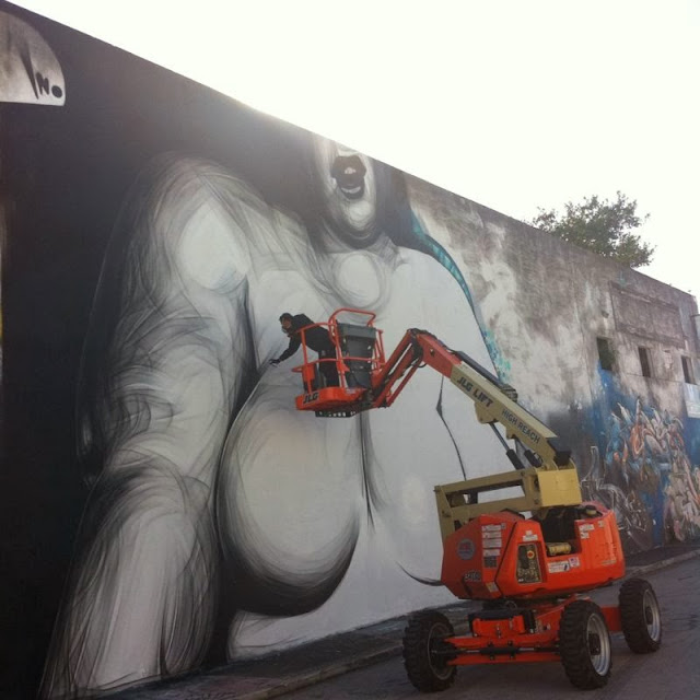Street art by Greek artist iNO in Miami, Florida for Art Basel 2013. 4