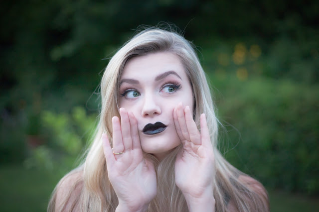 Pale girl wearing dark lipstick